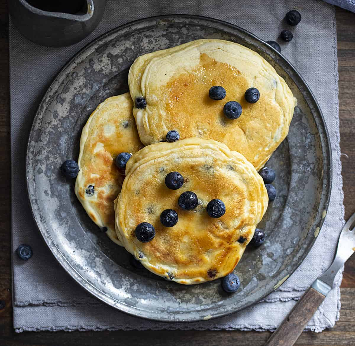 Overhead of Blueberry Sourdough Pancakes on Plate with Fork Next to It