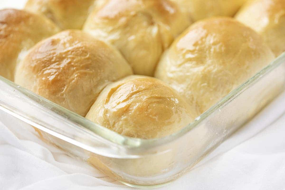 Texas Roadhouse Rolls In Baking Pan with Butter Brushed on Top
