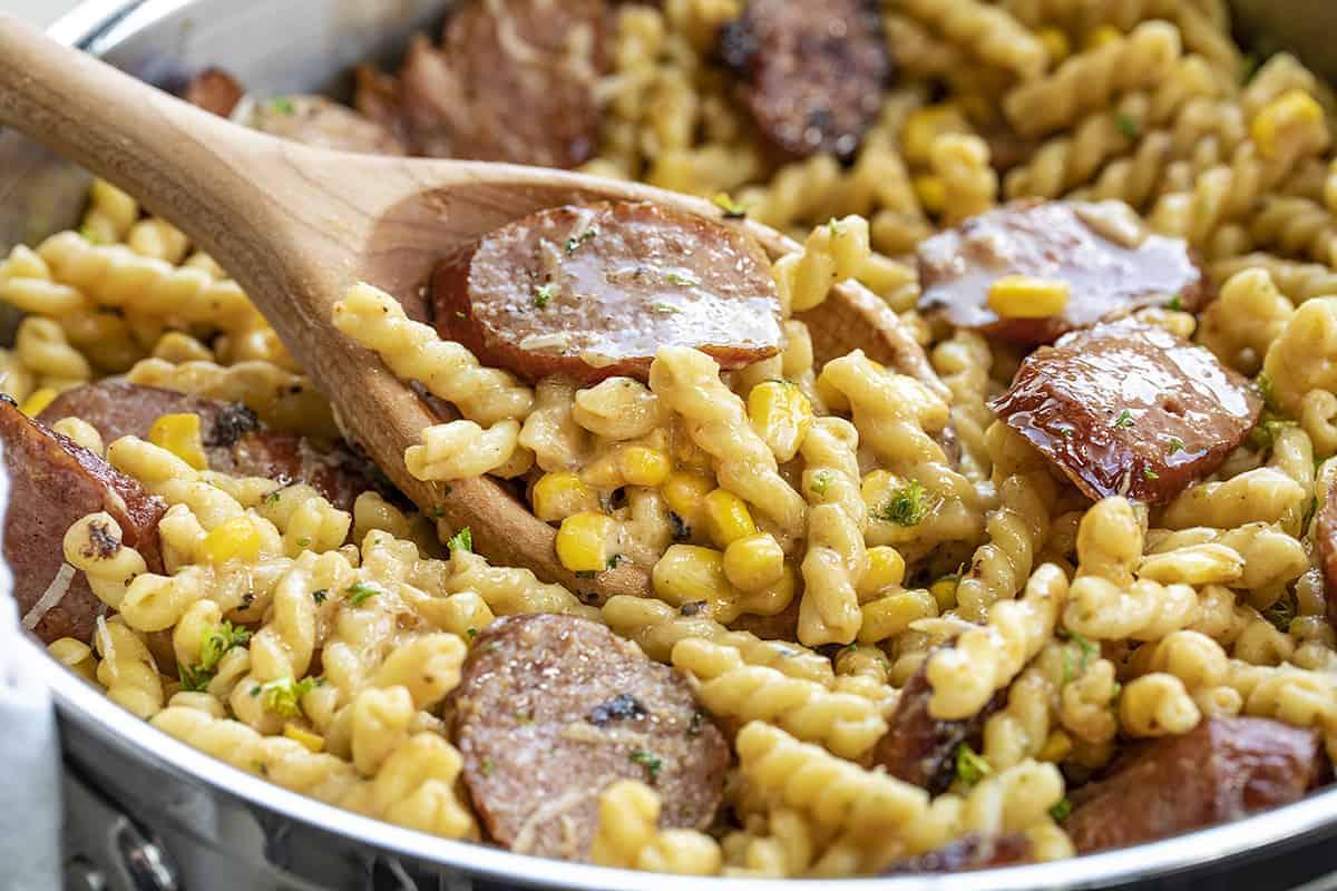 Wooden Spoon Picking Up Smoked Sausage Pasta