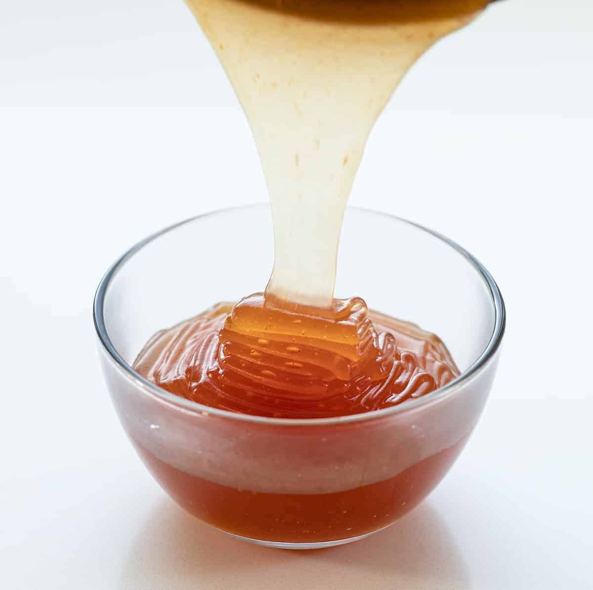 Pouring Hot Sweet and Sour Sauce into Cup