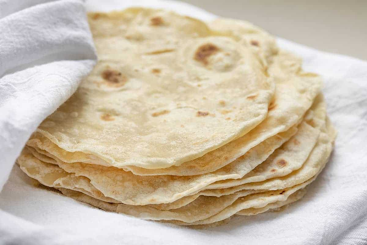 Homemade Tortillas Stacked on White Towel