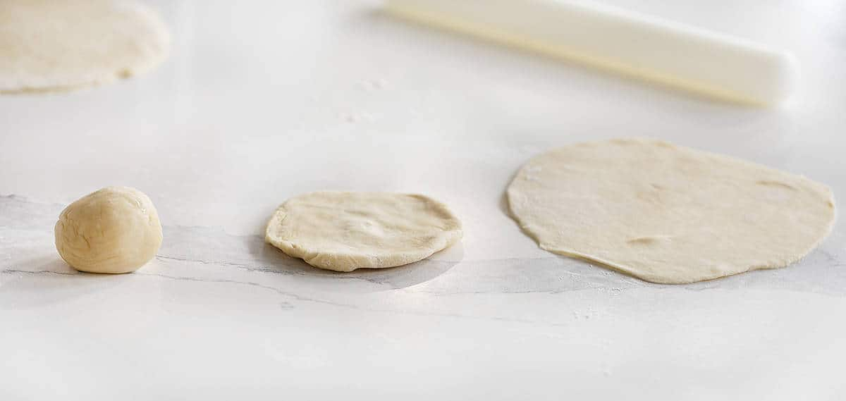 3 Stages of Making a Homemade Tortilla - Ball, Disc, Flattened