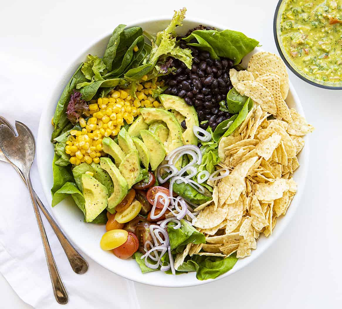 Overhead Image of California Guacamole Salad Before Ingredients are Tossed Together on White Surface