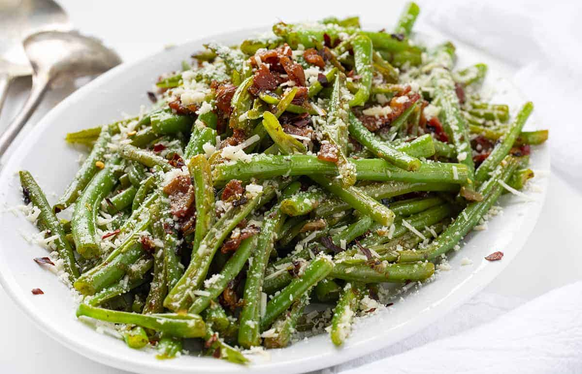 White Plate of Spicy Green Beans with Bacon and Cheese