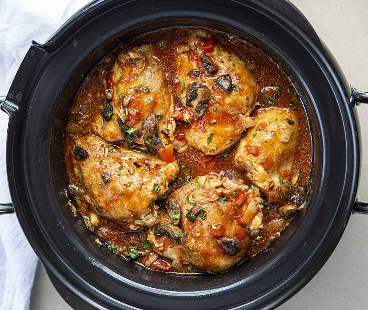 Overhead View of Slow Cooker Chicken Cacciatore in a Black Slow Cooker