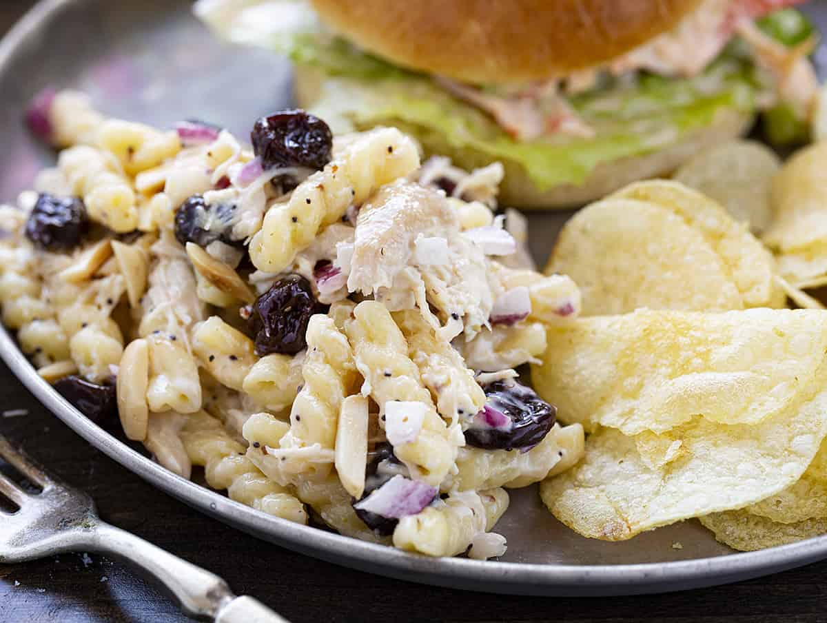 Cherry Chicken Pasta Salad on a Plate with Chips and a Burger
