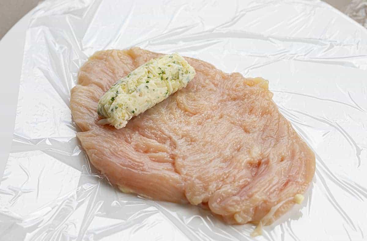 Adding Seasoned Butter to Flattened Chicken Bread