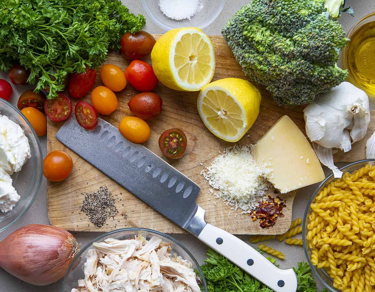 Raw Ingredients for Creamy Chicken Pasta with Roasted Vegetables on Cutting Board from Overhead