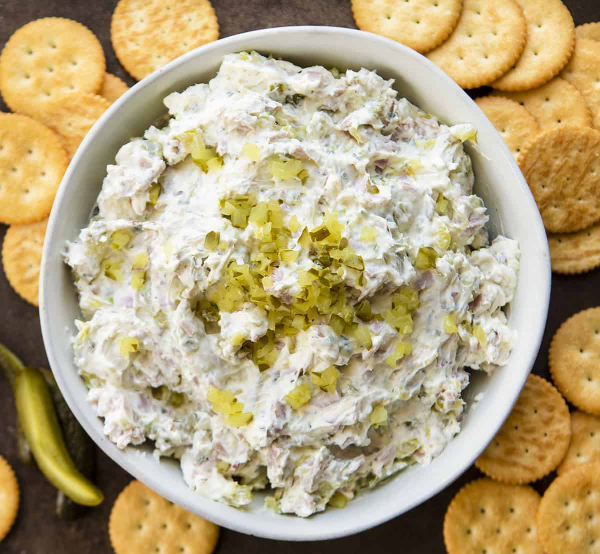Overhead Image of Dill Pickle Dip in White Bowl with Crackers Around Base