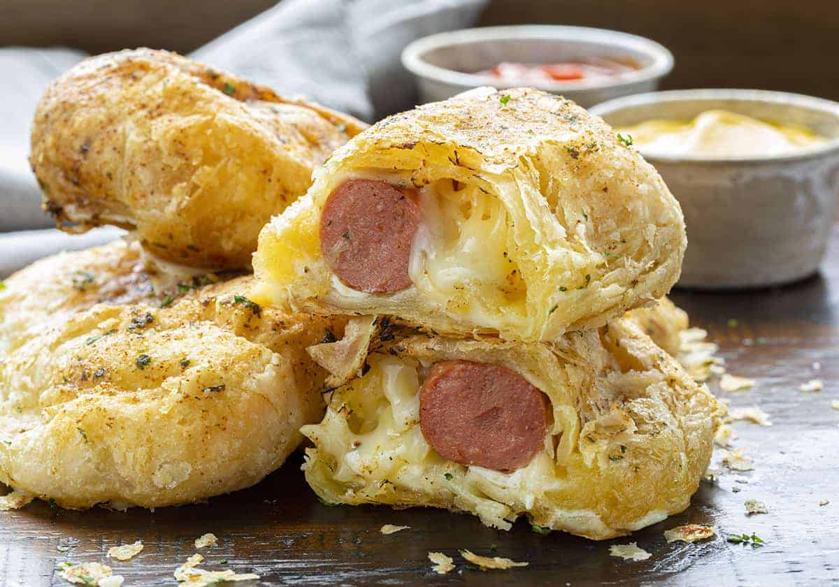Pig in a Blanket Cut in Half Showing Cheesy and Hot Dog Inside