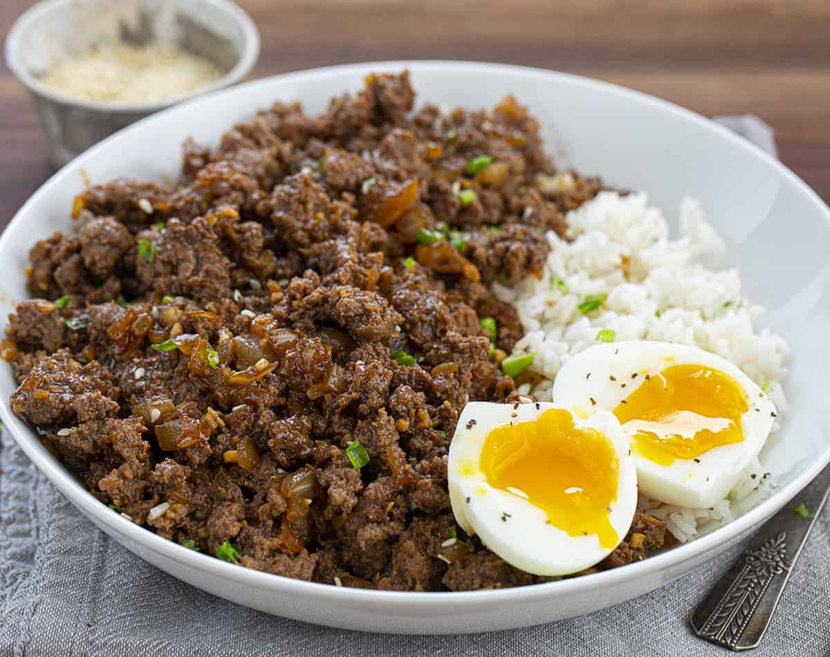 Beef Bulgogi in a White Bowl Served with Rice and Eggs