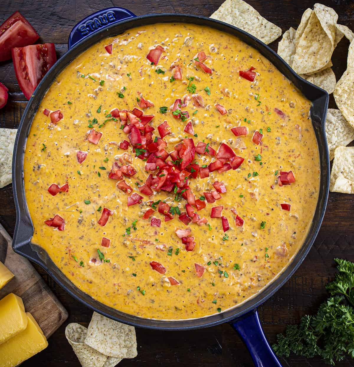 Cheesy Hamburger Rice Dip From Overhead in a Blue Skillet on a Cutting Board