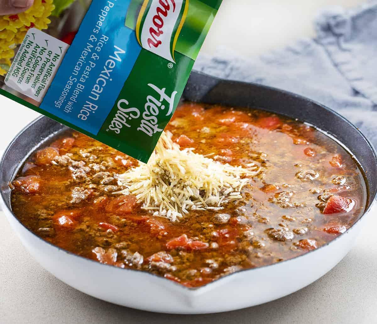 Adding Mexican Rice to Cheesy Hamburger Rice Dip