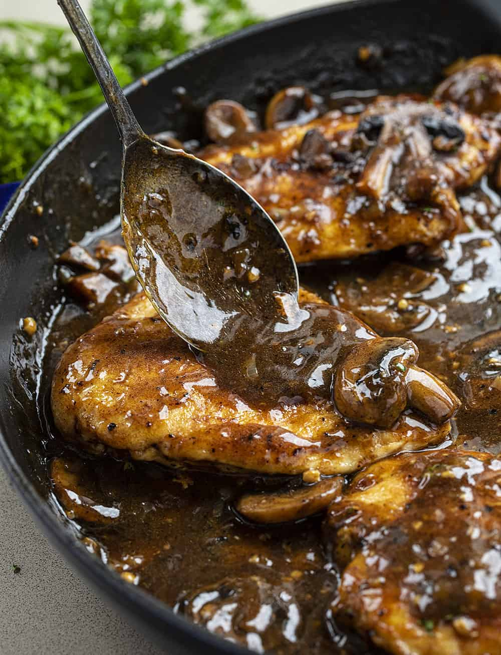 Adding Sauce to the chicken in pan for Chicken Marsala