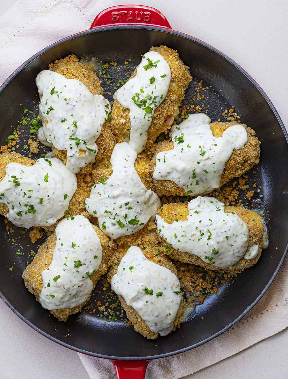 Overhead view of Baked Chicken Cordon Bleu in Red Skillet