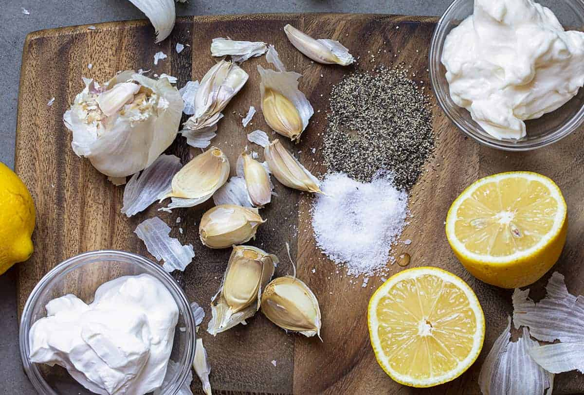 Raw Ingredients on a Cutting Board that Go Into Garlic Sauce