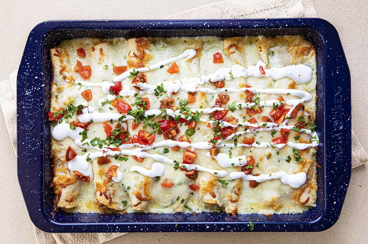 Overhead view of Cooked Cheesy Seafood Enchiladas in Blue Pan