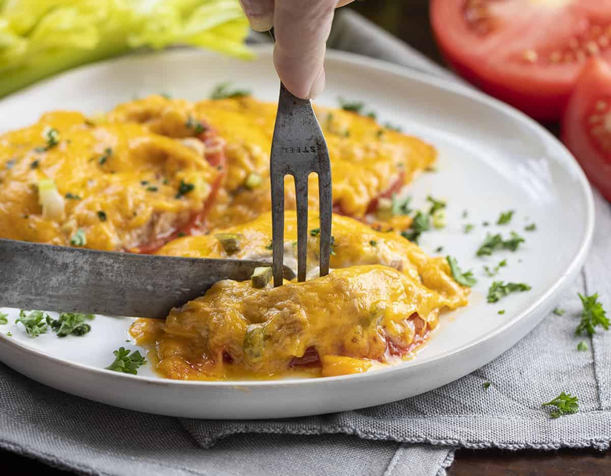Fork & Knife Cutting Into a Tomato Tuna Snack