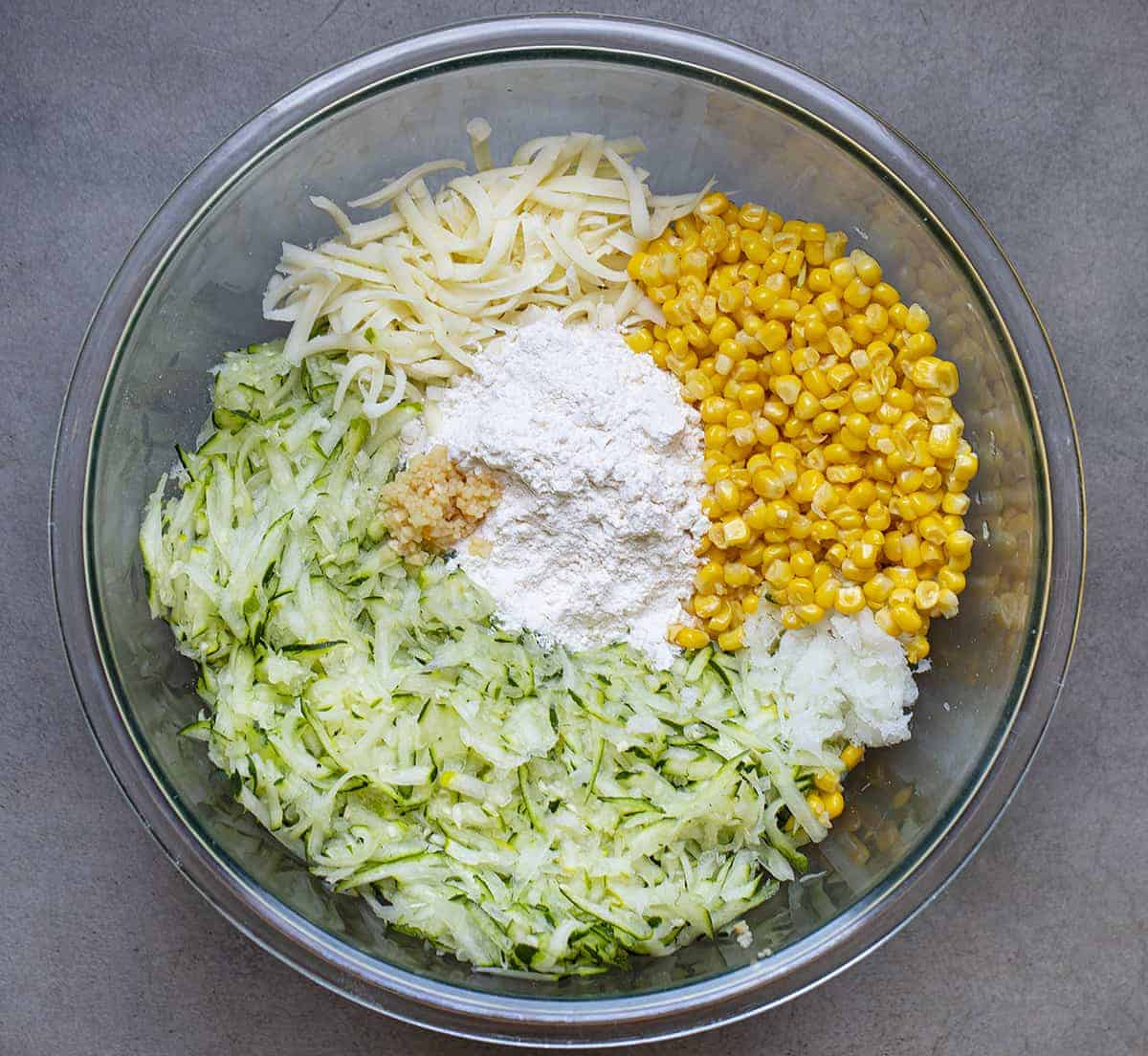 Raw Ingredients in a Bowl that Go into Zucchini Fritters