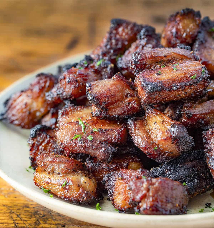 Air Fryer Crispy Pork Belly Bites on a Plate Very Close