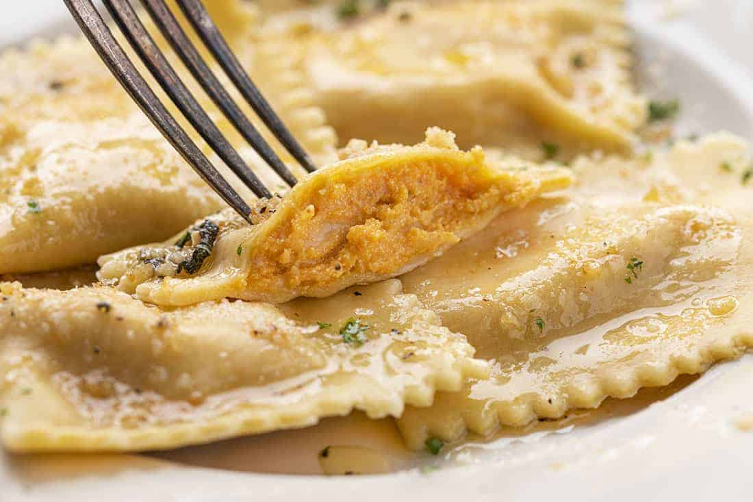 Cut Into Homemade Pumpkin Ravioli with Garlic Brown Butter Showing Inside Texture