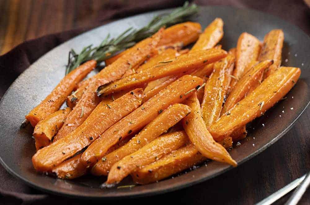 Air Fryer Carrots on a dark Platter