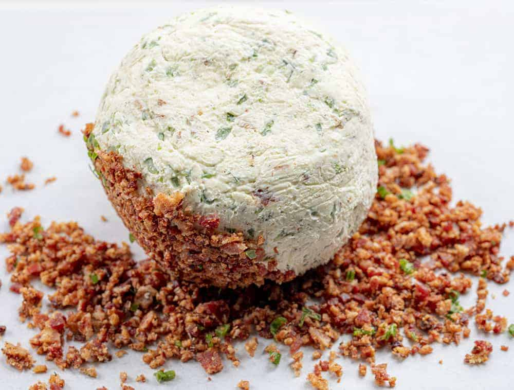 Rolling Cheeseball in Bacon and Jalapeno