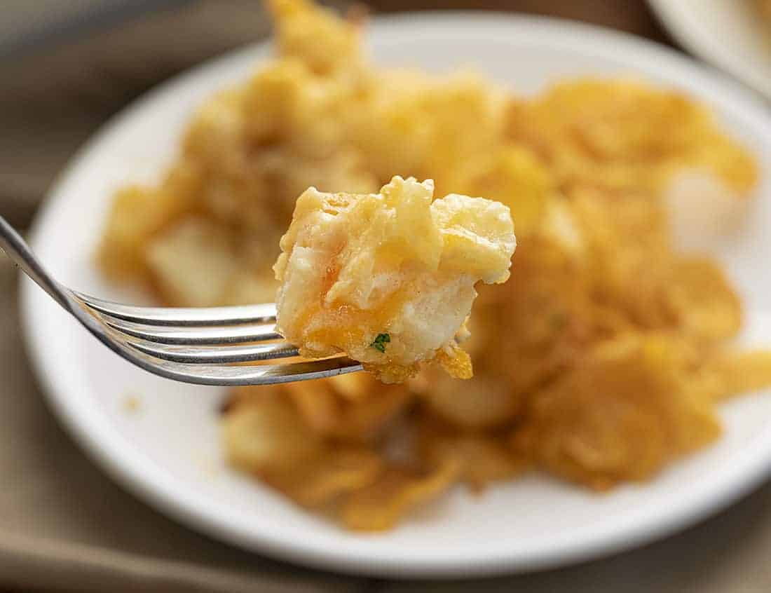 Fork with Funeral Potatoes - Cheesy Potato Casserole on It