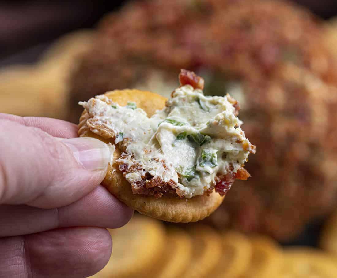 Dipping Cracker into Bacon Jalapeno Ranch Cheeseball