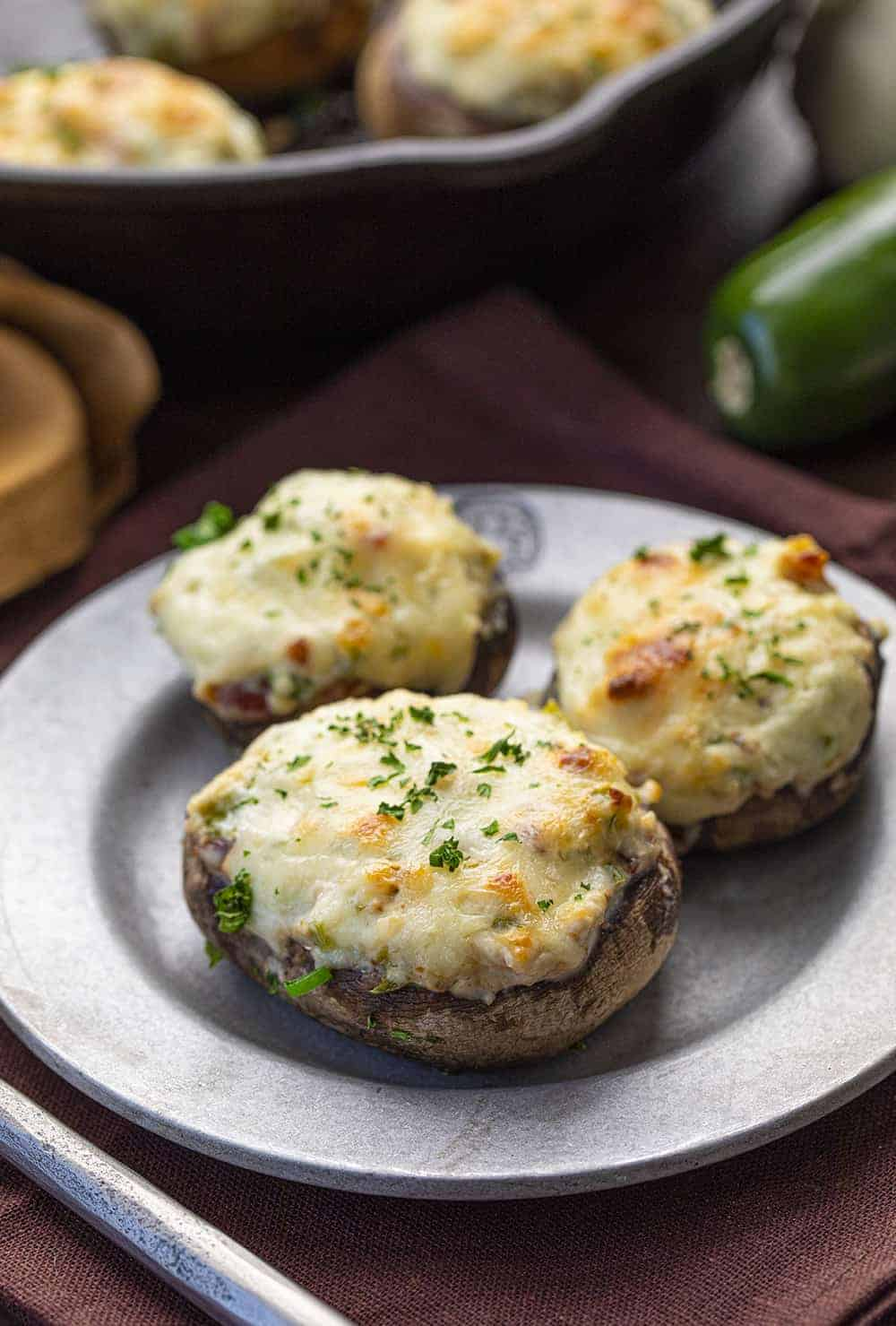Plate with Jalapeno Popper Stuffed Mushrooms on It