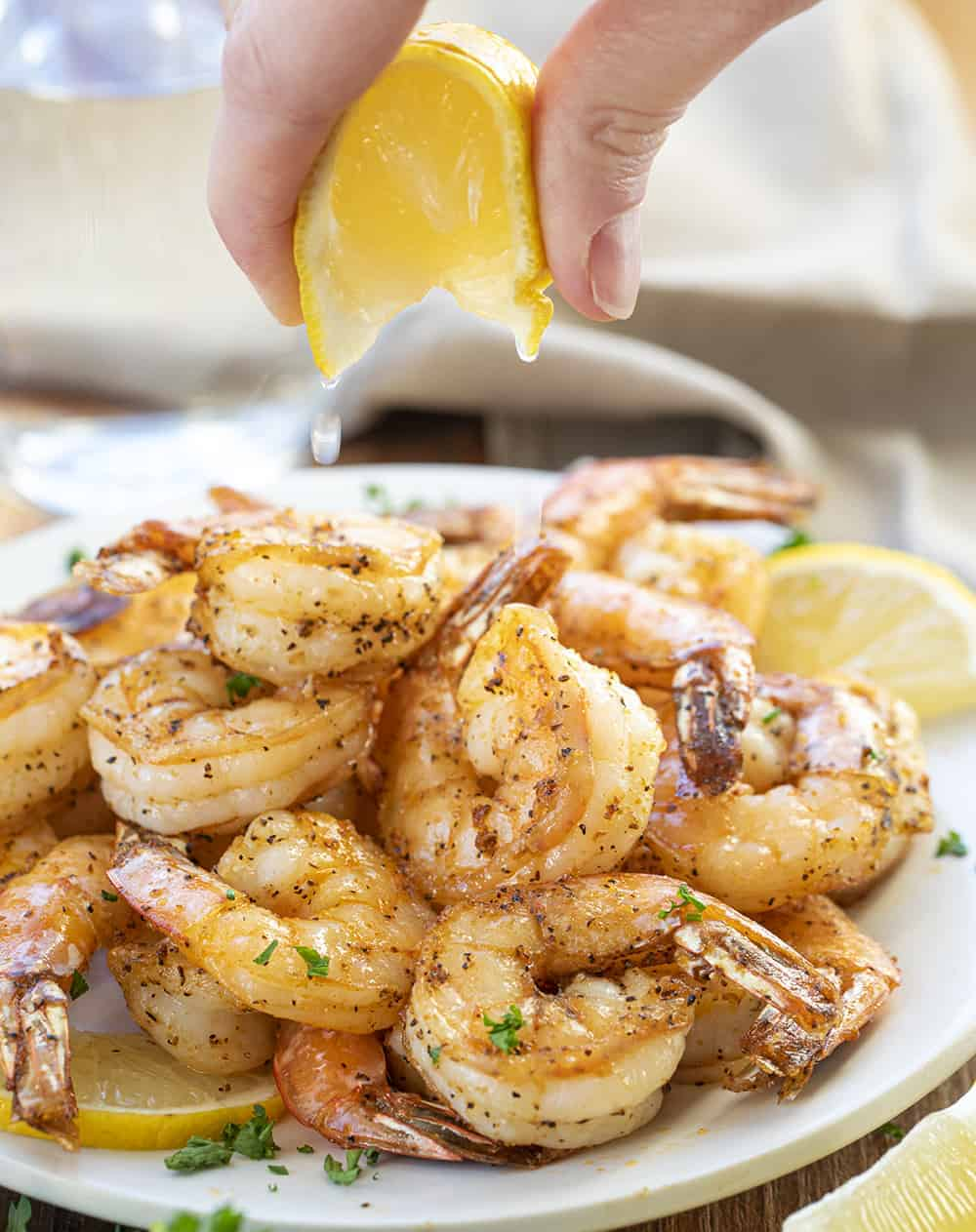 Squeezing Lemon over Air Fryer Shrimp