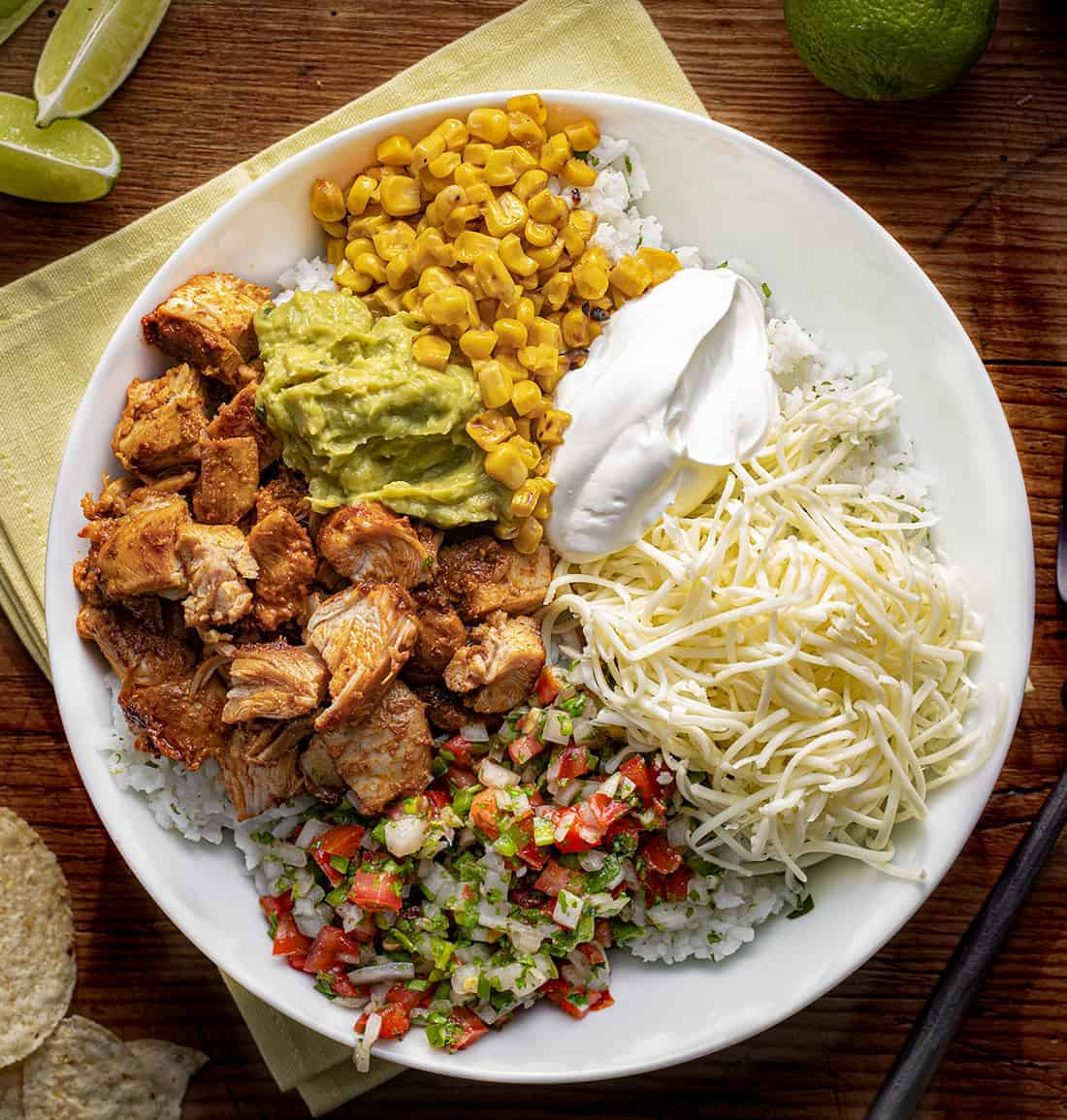 Bowl of Chipotle Chicken with Rice, Pico, cheese, Corn, and Guacamole