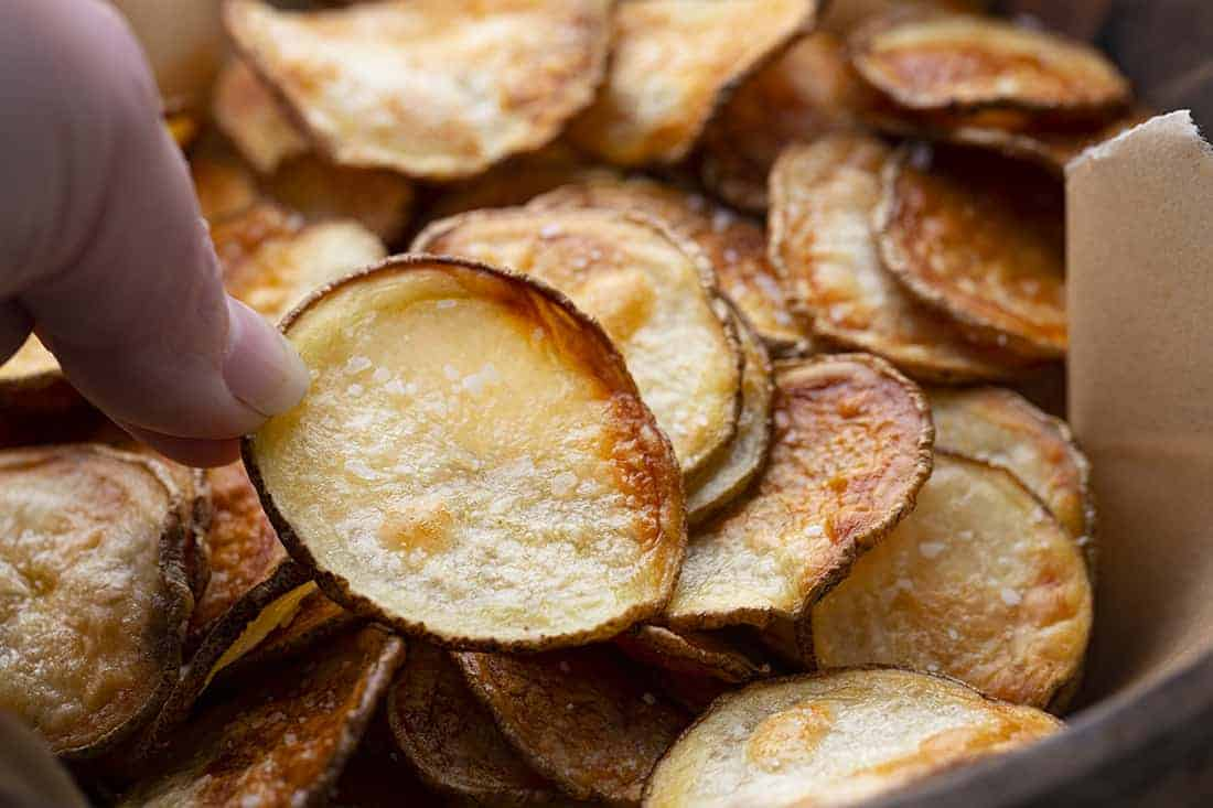 Hand Picking up Potato Chips