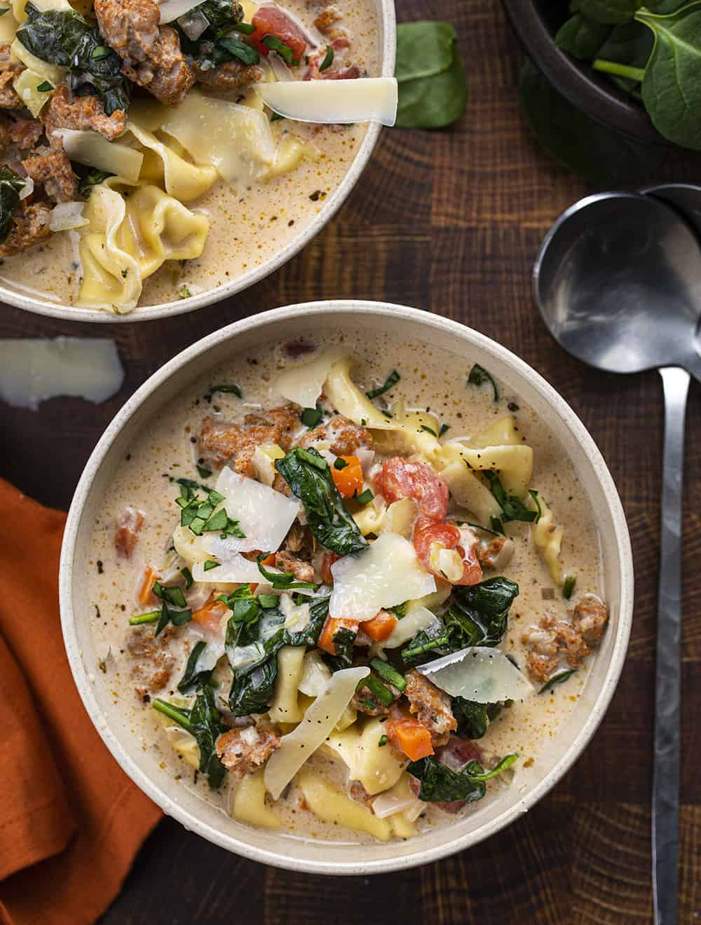 Overhead of bowls of Crockpot Sausage Tortellini Soup