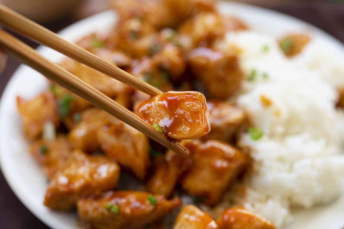 Chopsticks holding Easy Bourbon Chicken