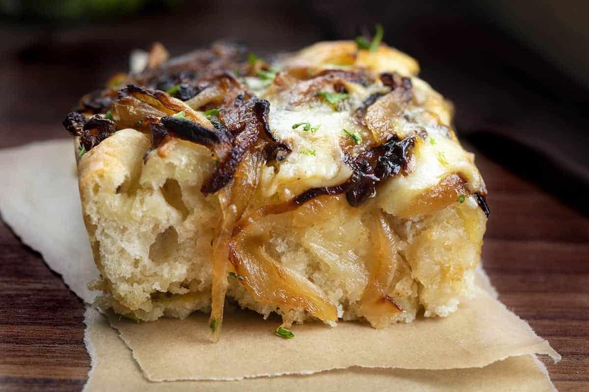 Piece of Cheesy Onion Focaccia Bread