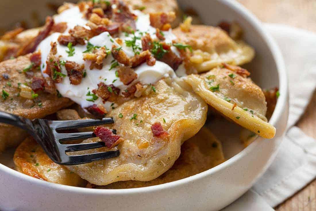 Fork Picking Up Pierogi Ruskie (Potato and Cheese Pierogi)