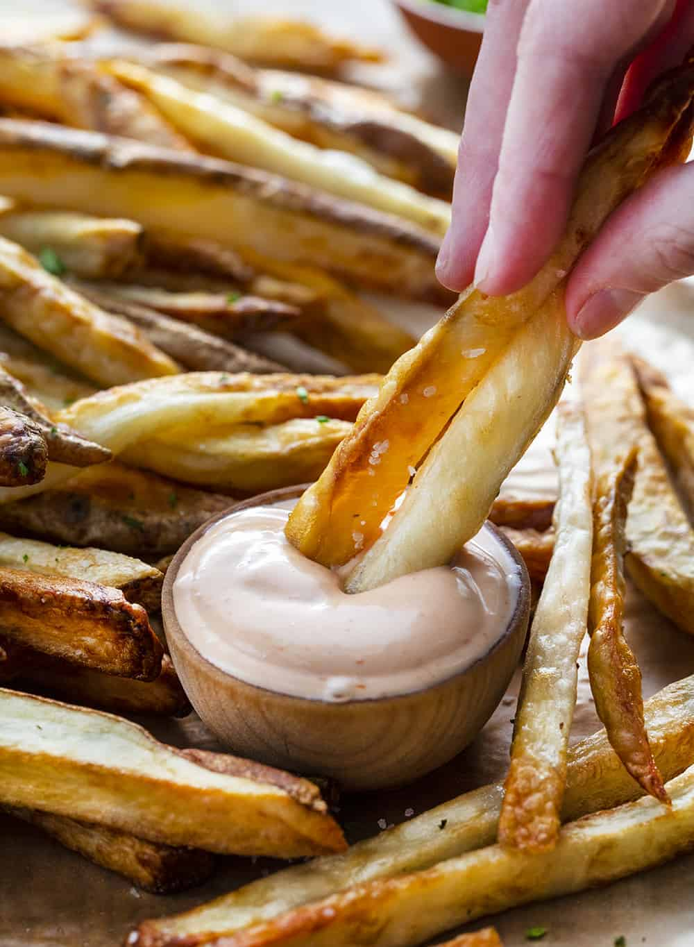 Dipping Air Fryer Salt & Vinegar French Fries into Fry Sauce