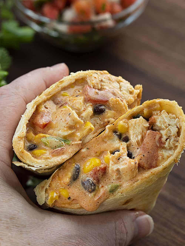 Hand Holding Air Fryer Southwest Chicken Burrito