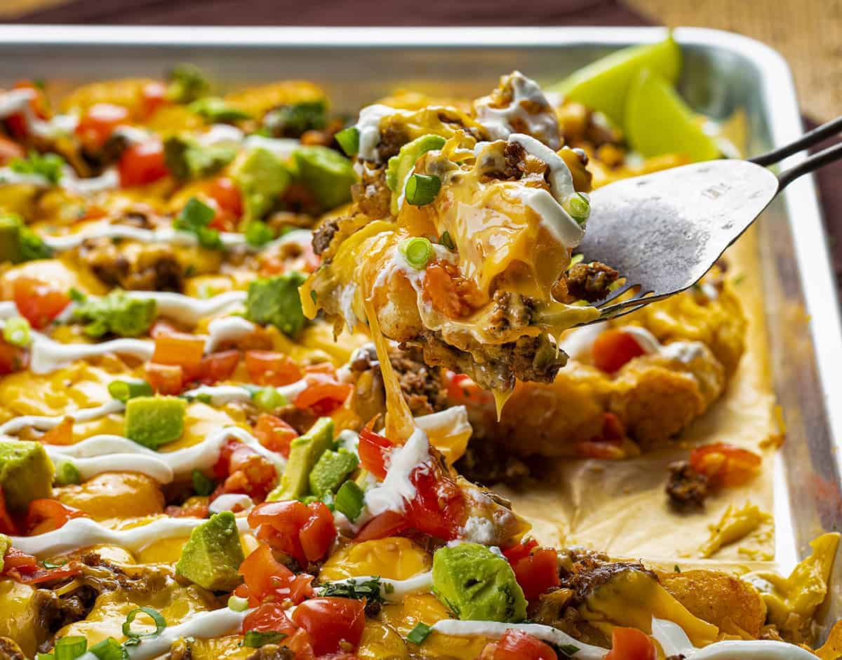 Spatula full of Loaded Tater Tot Nachos