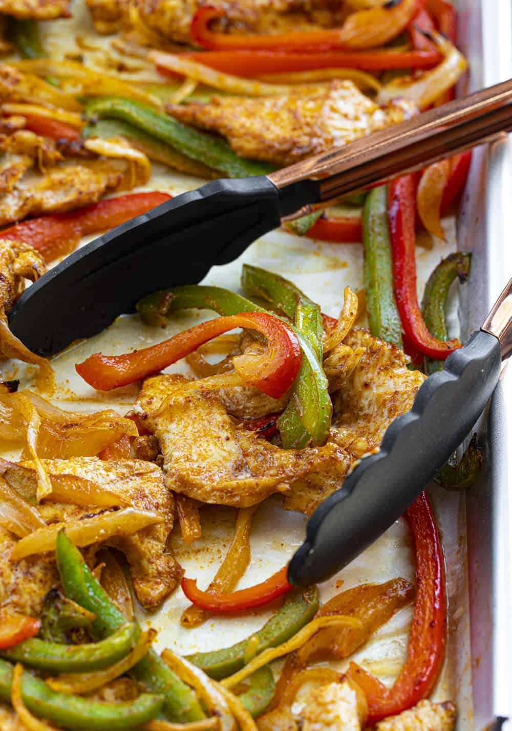 Tongs on Sheet Pan Chicken Fajitas