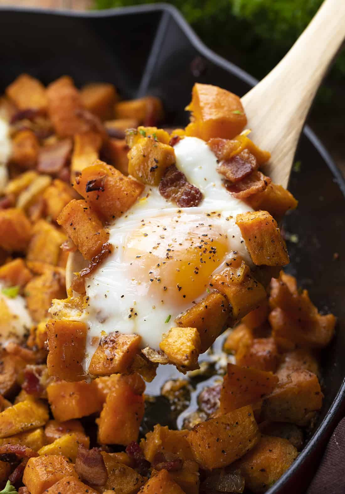 Wooden Spoon Picking up Sweet Potato Hash