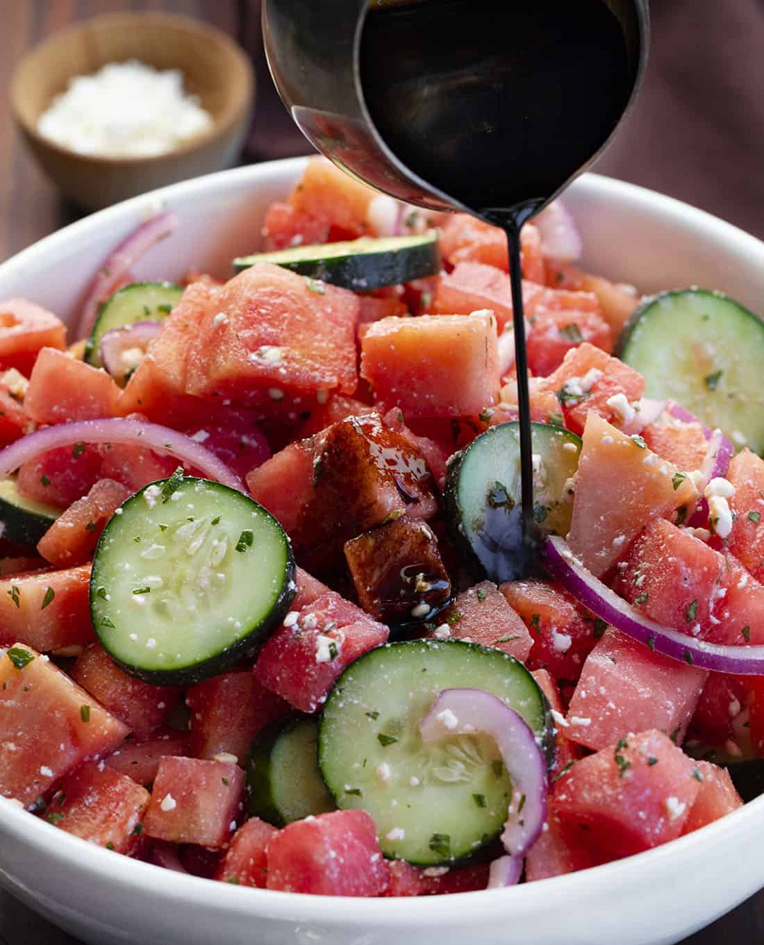Pouring Balsamic OVer Watermelon Feta Salad