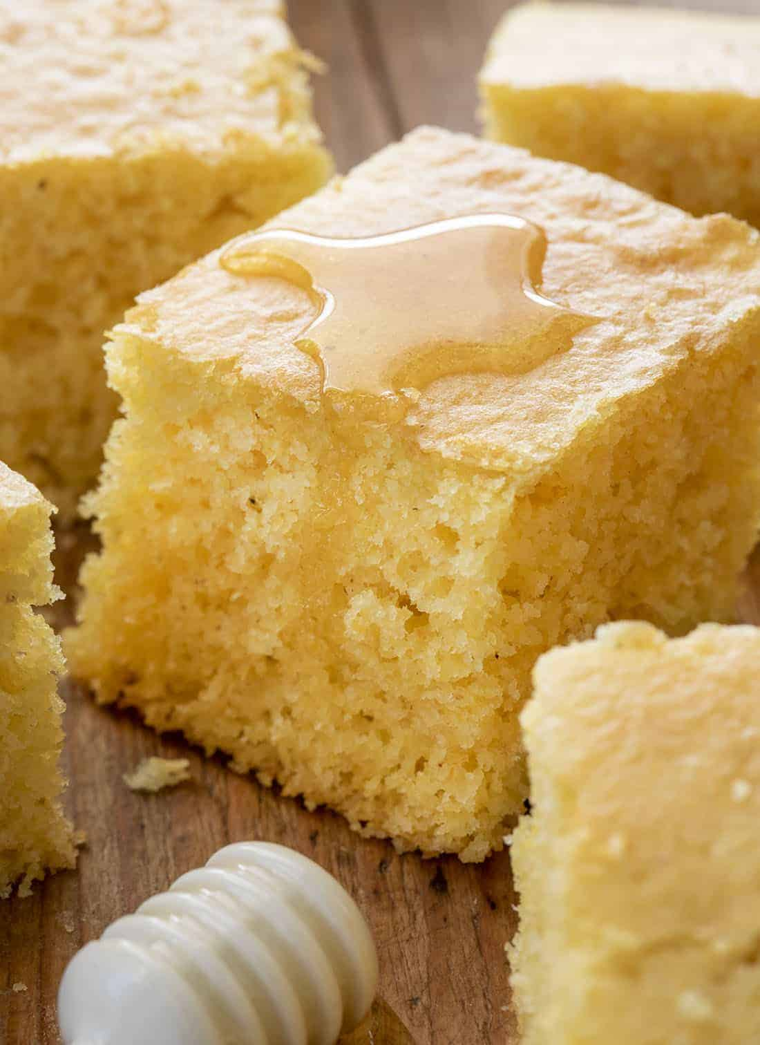 Slice of Homemade Cornbread with Honey Drizzled on Top